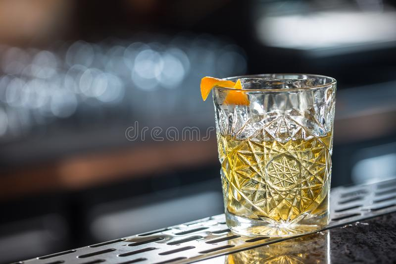 Cocktail drink old fashioned at barcounter in night club or restaurant stock photo
