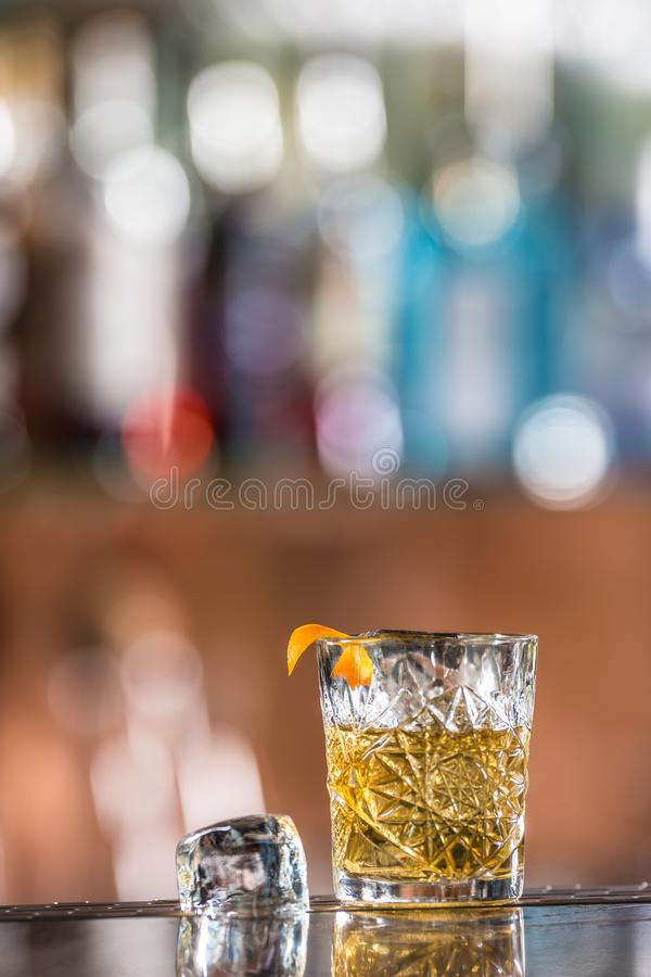 Cocktail drink old fashioned at barcounter in night club or restaurant royalty free stock image