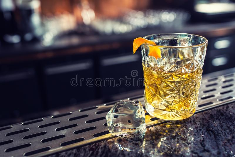 Cocktail drink old fashioned at barcounter in night club or restaurant royalty free stock photo