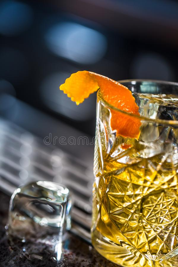 Cocktail drink old fashioned at barcounter in night club or restaurant stock image