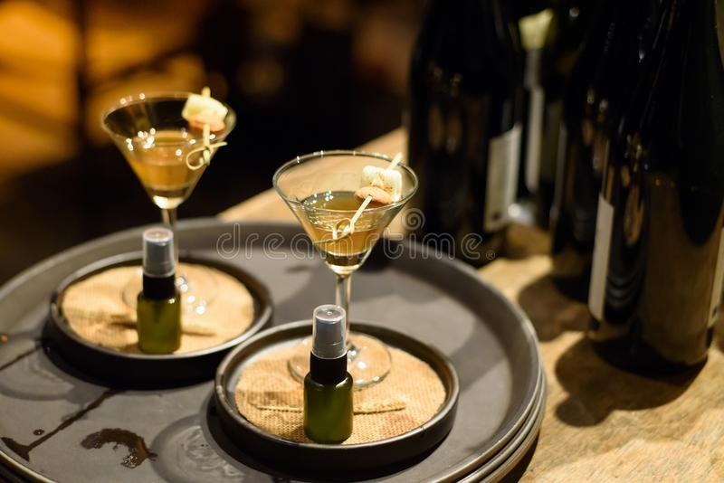 Cocktail food serving in martini glass near wine bottle. Cocktail food serving in martini glass at the party stock images