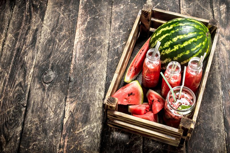 Cocktail of fresh watermelons in bottles. stock image