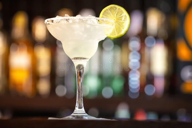 Cocktail garnished with lime. royalty free stock photo