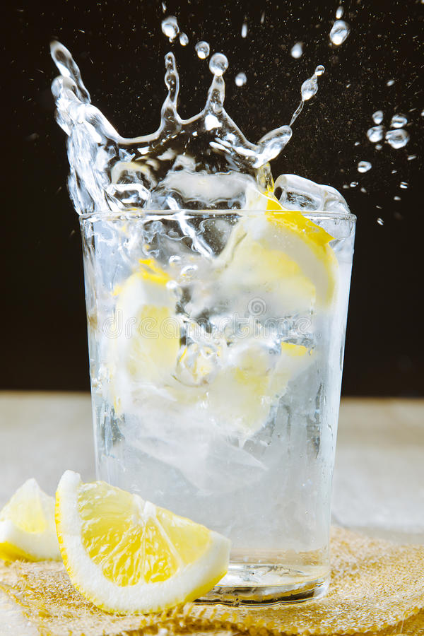 Cocktail with gin and tonic. Splashing royalty free stock image