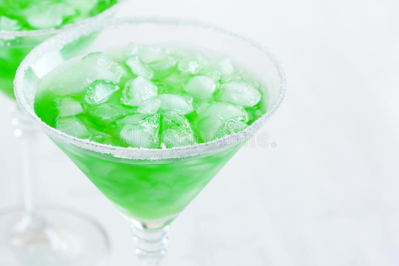 Cocktail. Glass of green cocktail closeup royalty free stock photo