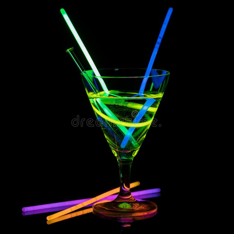 Cocktail glass with neon light. royalty free stock images