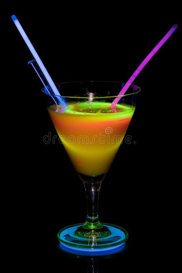 Cocktail glass with neon light. royalty free stock image