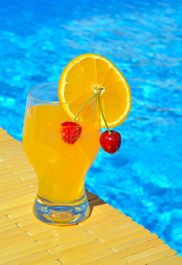 Free Cocktail Glass With Orange And Cherry Stock Photos - 58042353
