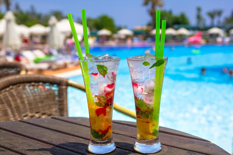 Cocktail glasses at the pool royalty free stock photography