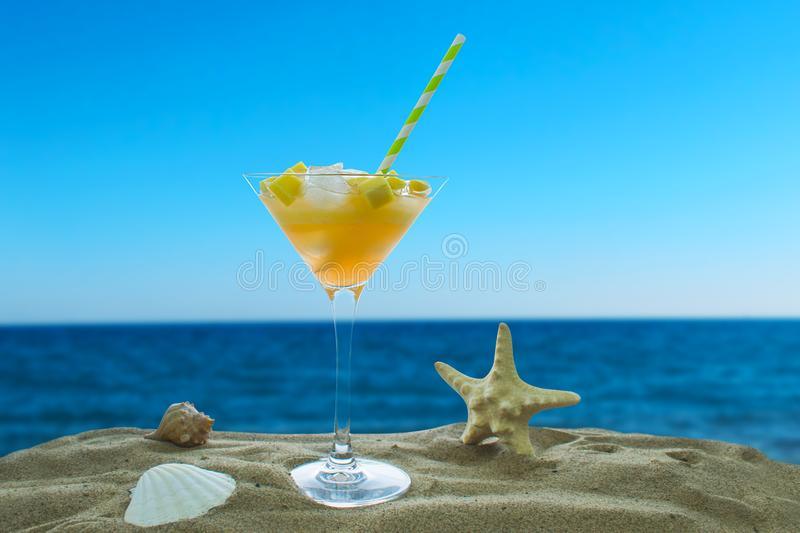 Cocktail with ice on the ocean stock image