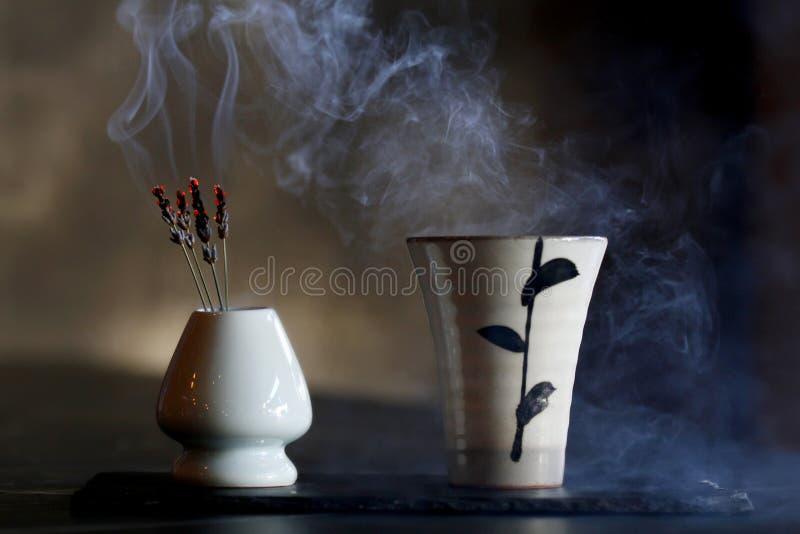 Cocktail with japanese saki and smoke royalty free stock photo