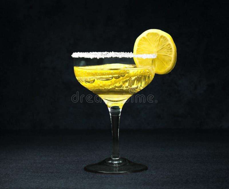 Cocktail with lemons close-up stock photos