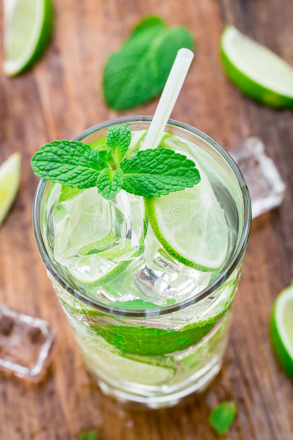 Cocktail with lime and mint royalty free stock photos