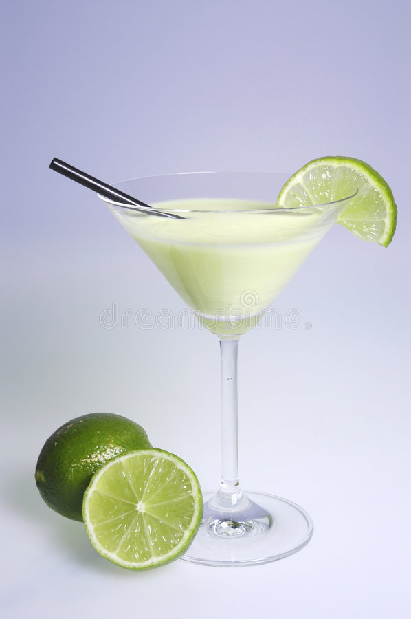 Cocktail with limes stock image