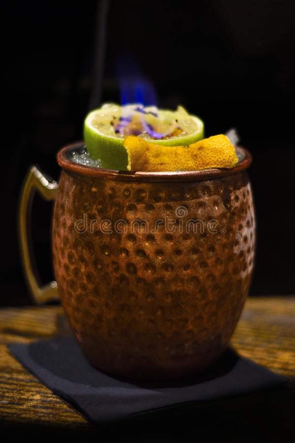 Moscow mule cocktail with flame stock image