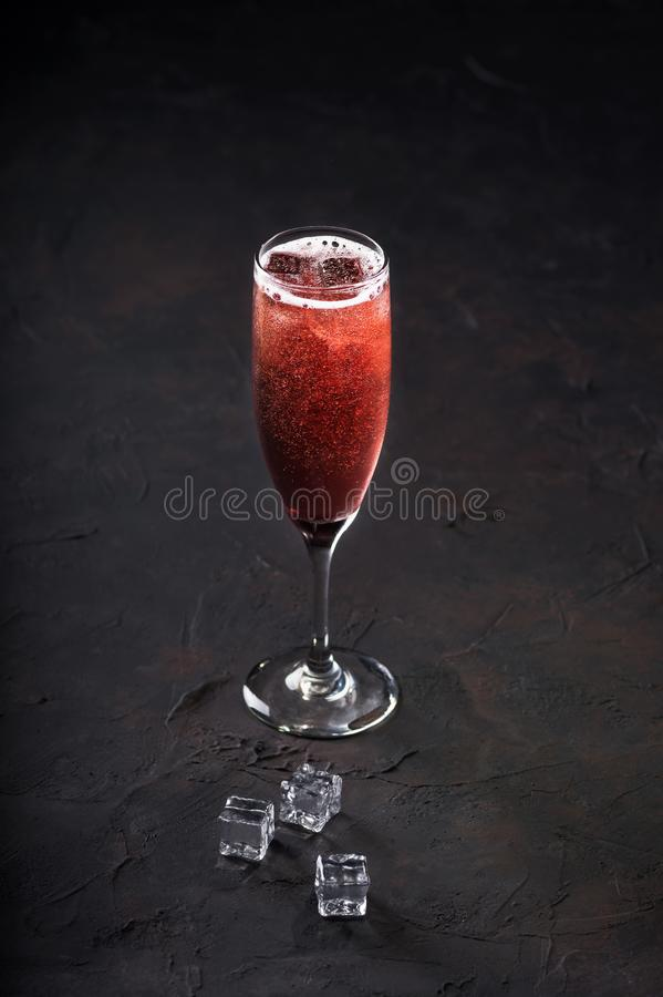 Cocktail mimosa champagne with ice in glasses on a dark background. Copy space royalty free stock photography