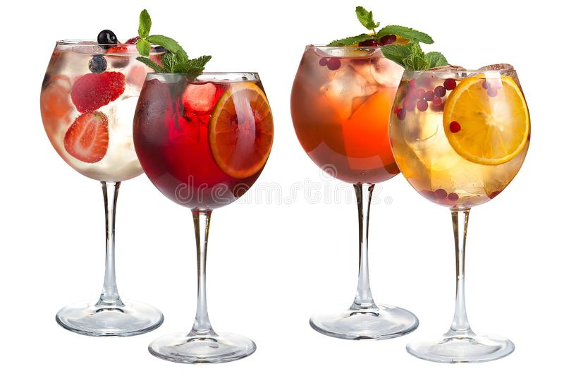 Cocktail with mint, fruits and berries on a white background. A set of four cocktails in glass glasses on a long leg stock image