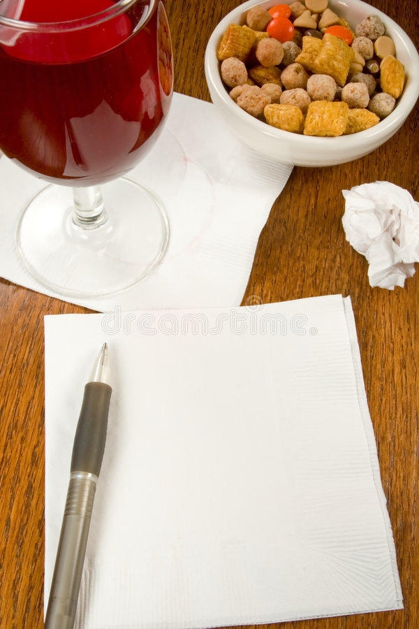 Cocktail Napkin Ideas. Ideas, charts, innovation on a cocktail napkin in a bar with wine and snacks royalty free stock photos