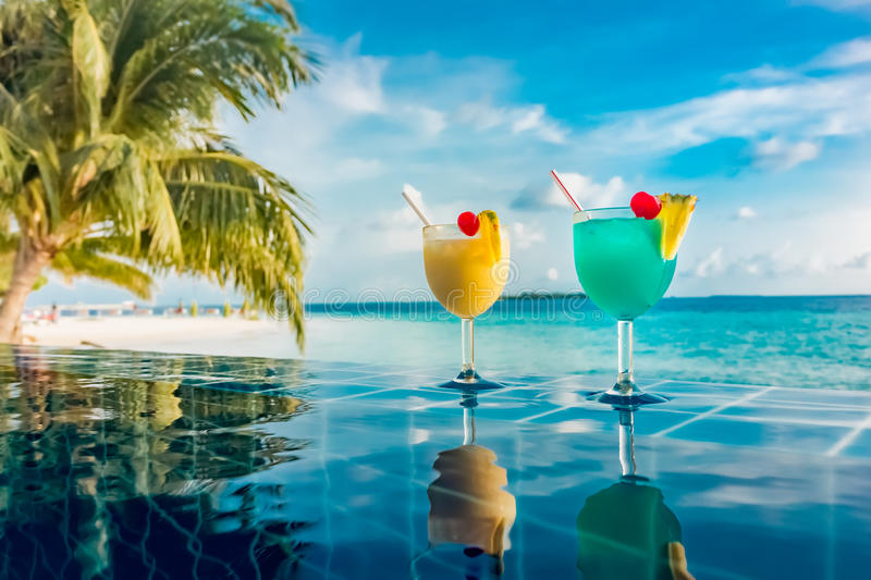 Cocktail near the swimming pool. On the background of the Indian Ocean, Maldives stock photo