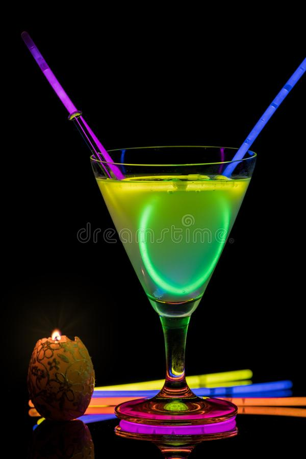 Cocktail with neon lights and candlelight. royalty free stock photography