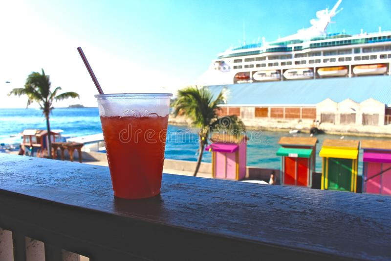 Cocktail overlooking cruise ship and the waters of Nassau, Bahamas stock photo