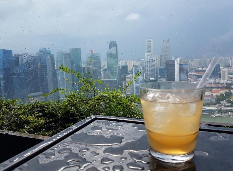 Cocktail with a panoramic city skyline royalty free stock photos