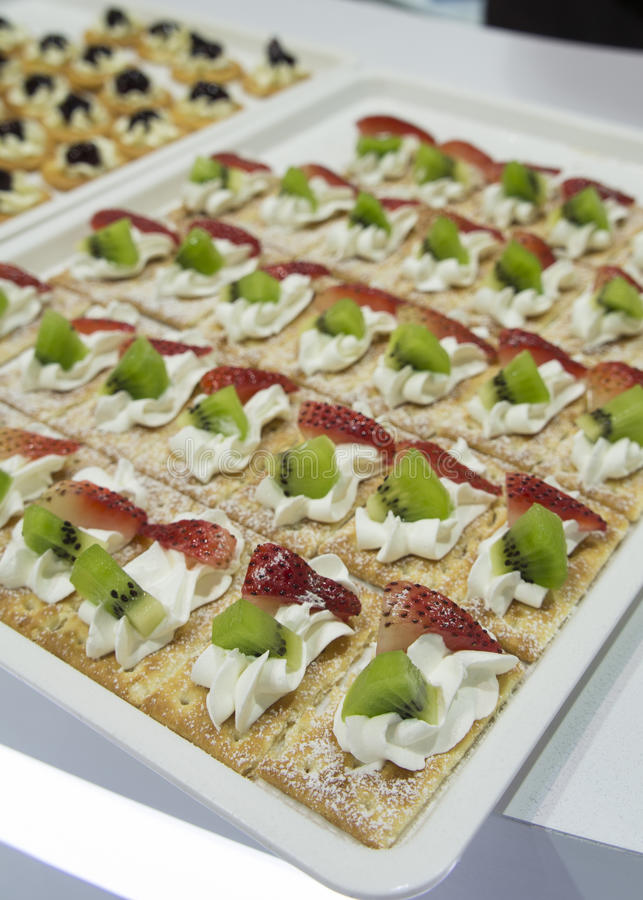 Cocktail party canape fruit desert cream tray concept stock images