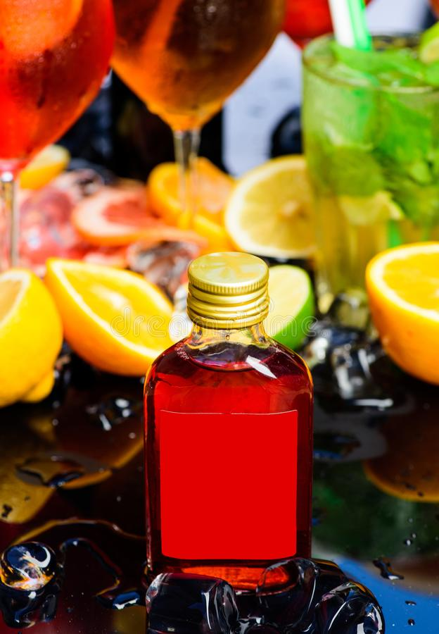 Cocktail party. Whiskey cocktail drinks in glasses. Cocktails garnished with ice cubes, fruit and mint. Drink reception. Alcohol addiction and bad habit. The royalty free stock image