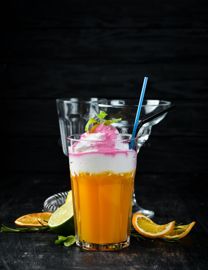Cocktail Peach Paradise. Peach juice, cream, cherry syrup stock photography