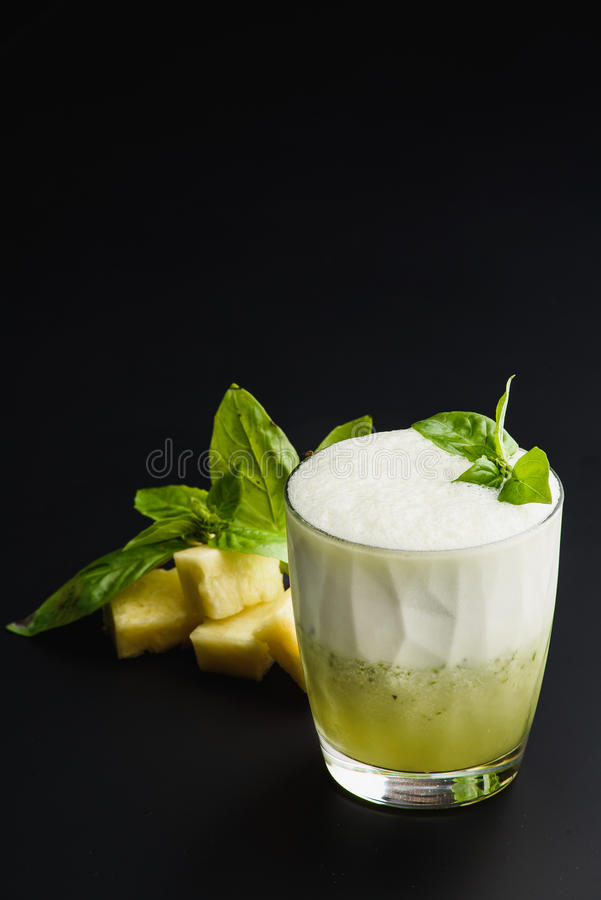 Cocktail `pineapple and basil` healthy drink stock photo