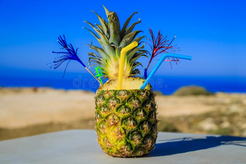 Cocktail in Pineapple on the beach. On the island Cyprus in the summer royalty free stock images
