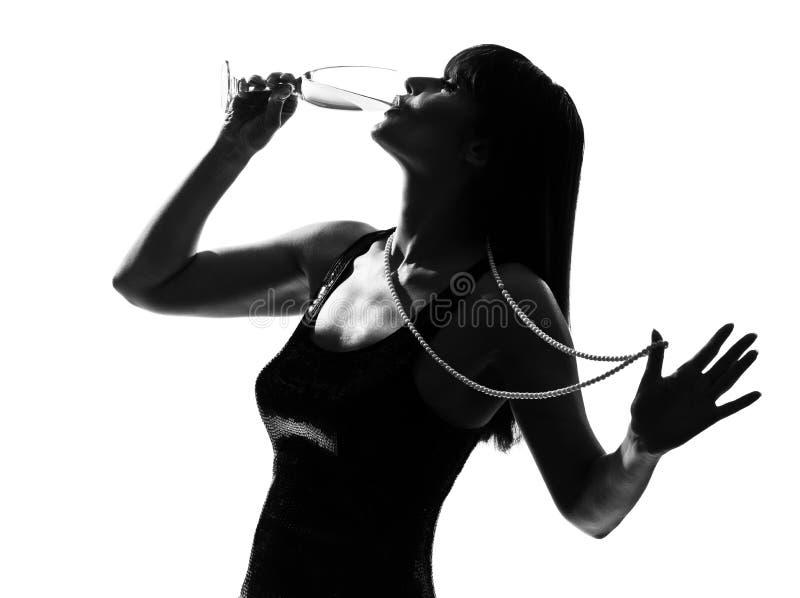 cocktail potable partying de champagne de silhouette images stock