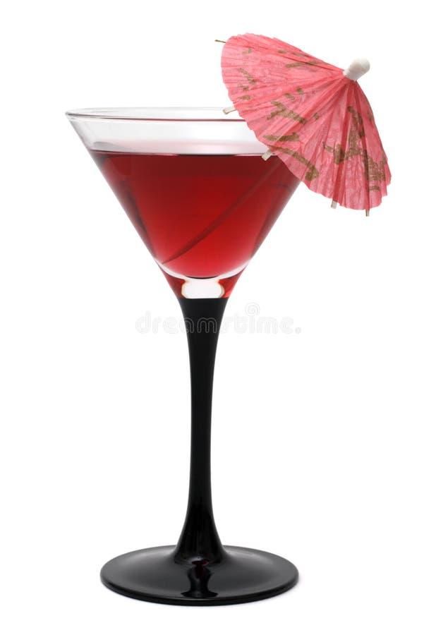 Cocktail rosso con un ombrello fotografia stock