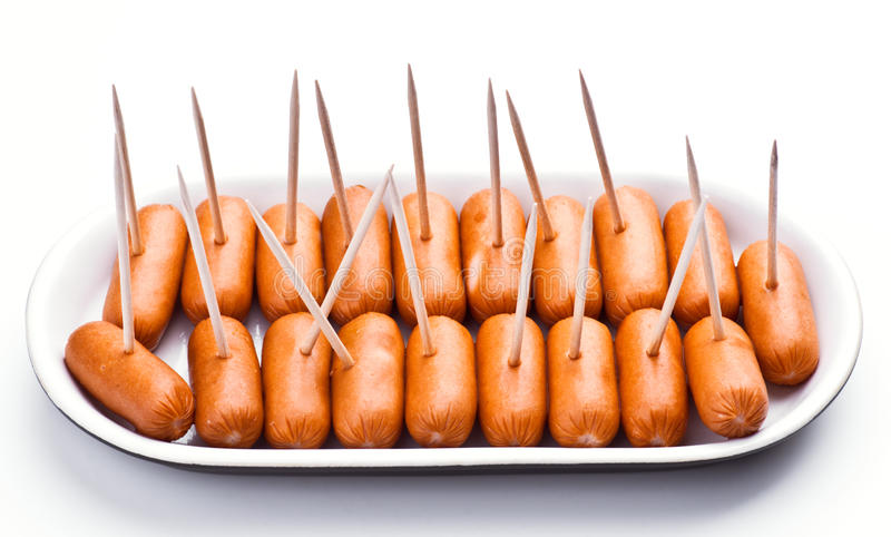 Cocktail sausages. Punctured tray with chopsticks stock photography