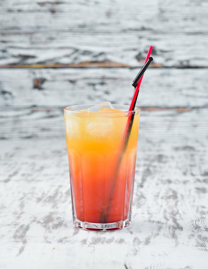 Cocktail Sex on the Beach. Orange juice, vodka, grenadine. On a wooden background. Top view royalty free stock images