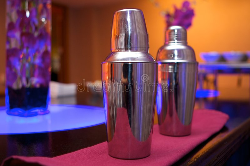 Cocktail shakers in an upscale bar royalty free stock images