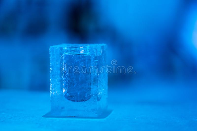 Cocktail short glass made of ice. In Igloo ice bar in winter season stock image