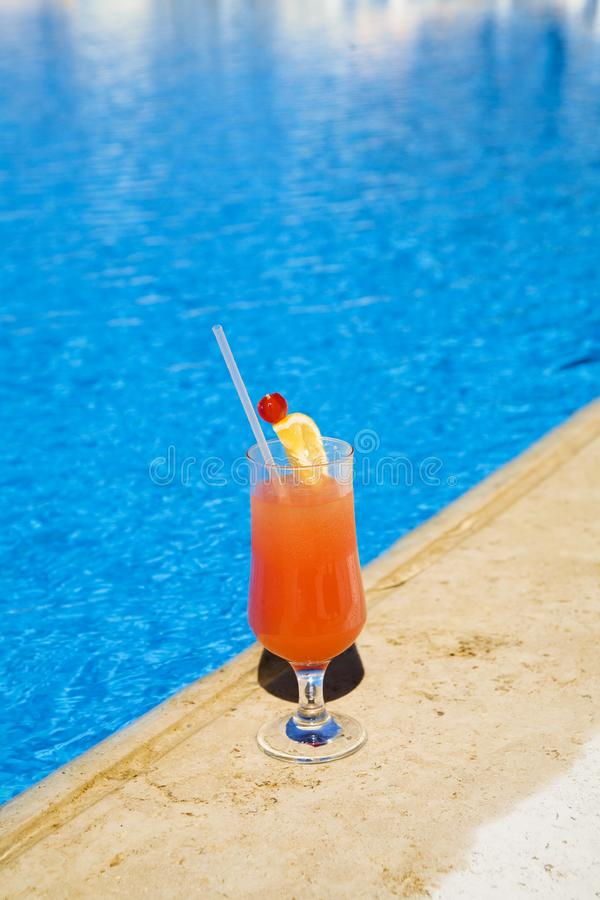 Cocktail stands on edge of pool. stock photos