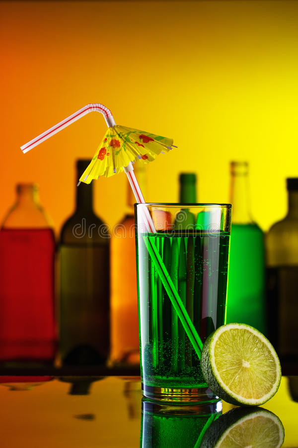 Cocktail with straw and lime stock photo