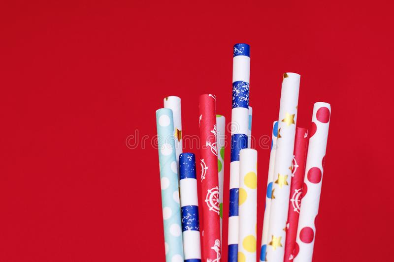 Cocktail tubes for drinks on a red background stock images