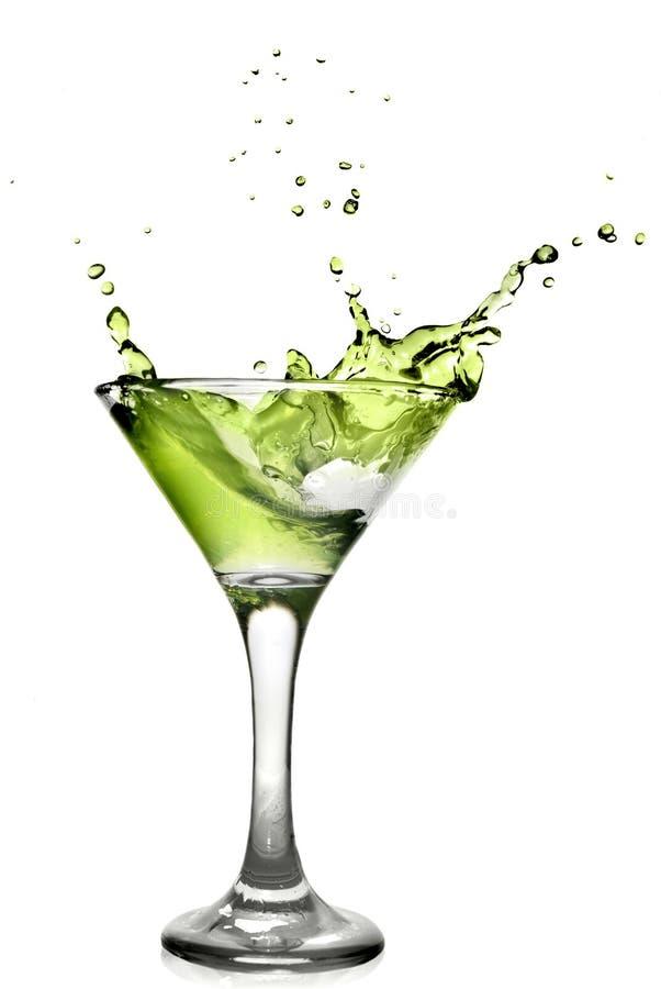Cocktail vert d'alcool avec l'éclaboussure photo stock