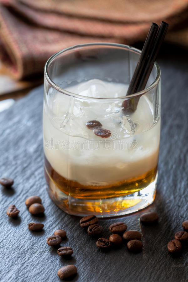 Cocktail white Russian with vodka, coffe, liqueur, cream stock image