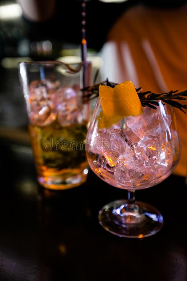 Cocktails by a barmen in a nightclub - Bartender skills are shown royalty free stock image
