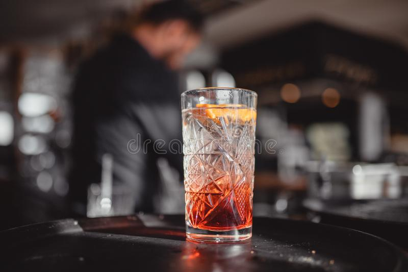 Cocktails in a cocktail bar with orange and red royalty free stock photo
