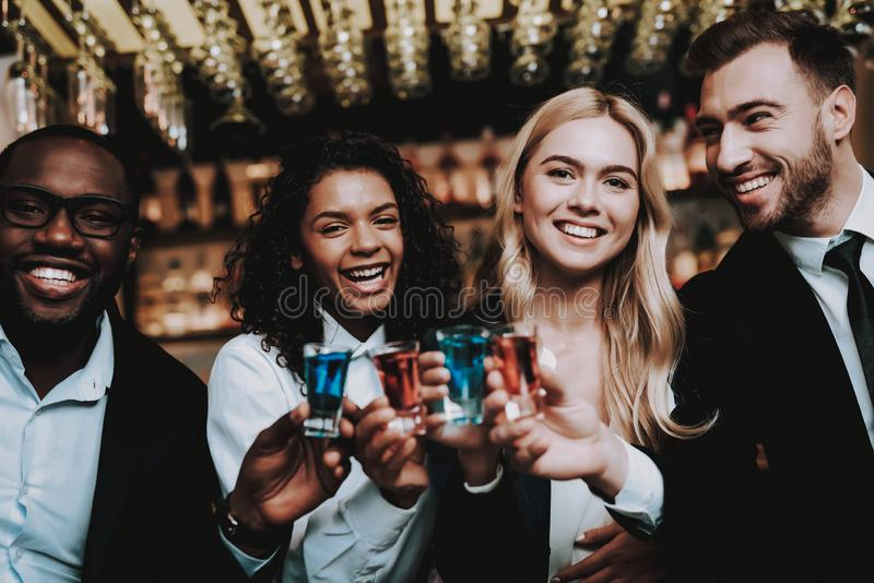 Cocktails. Joyful. Chin-Chin. Girls and Guys. stock photo