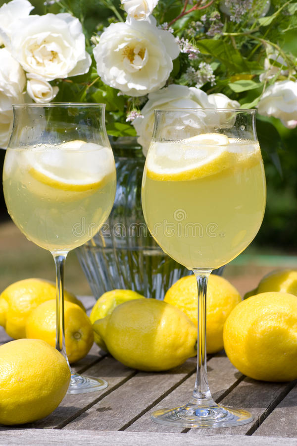 Cocktails with lemons in the garden stock images