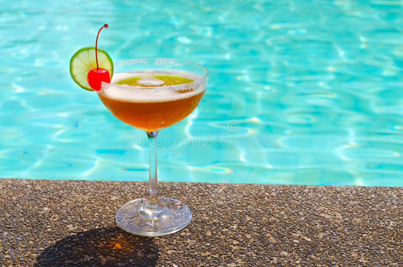 Cocktails near the swimming pool on summer royalty free stock photography