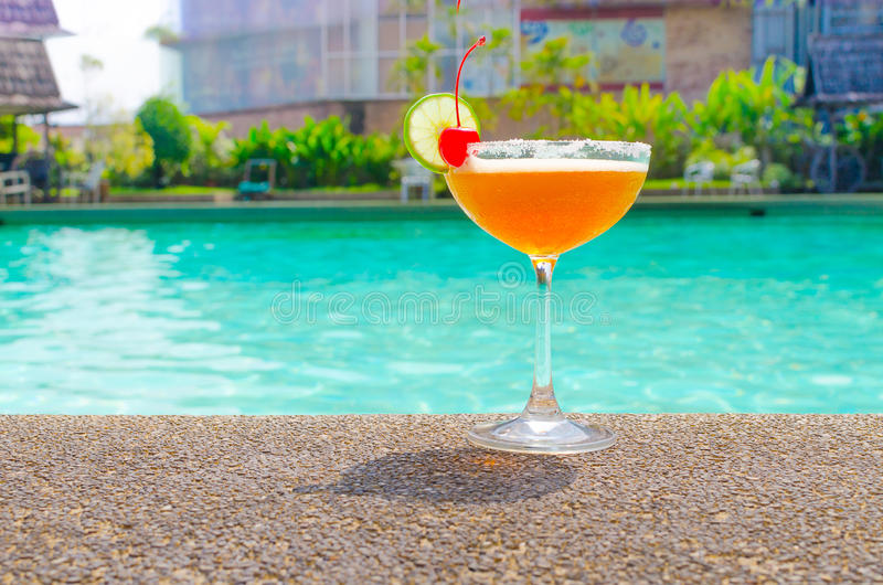 Cocktails near the swimming pool on summer royalty free stock photos