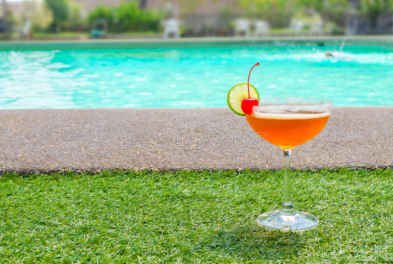 Cocktails near the swimming pool on summer stock photos