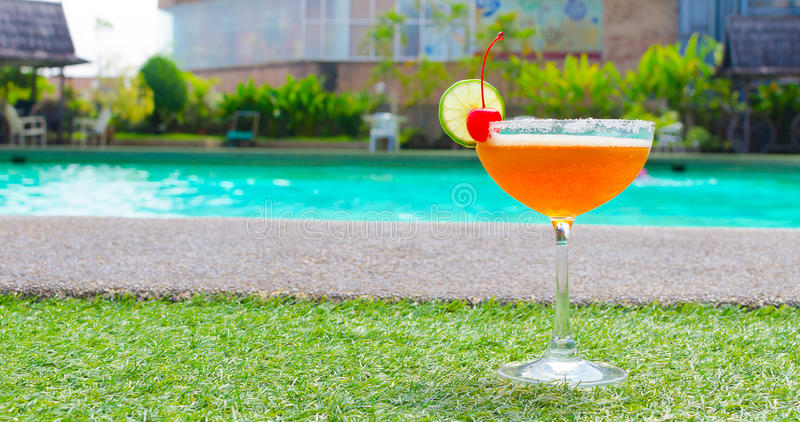 Cocktails near the swimming pool on summer stock images